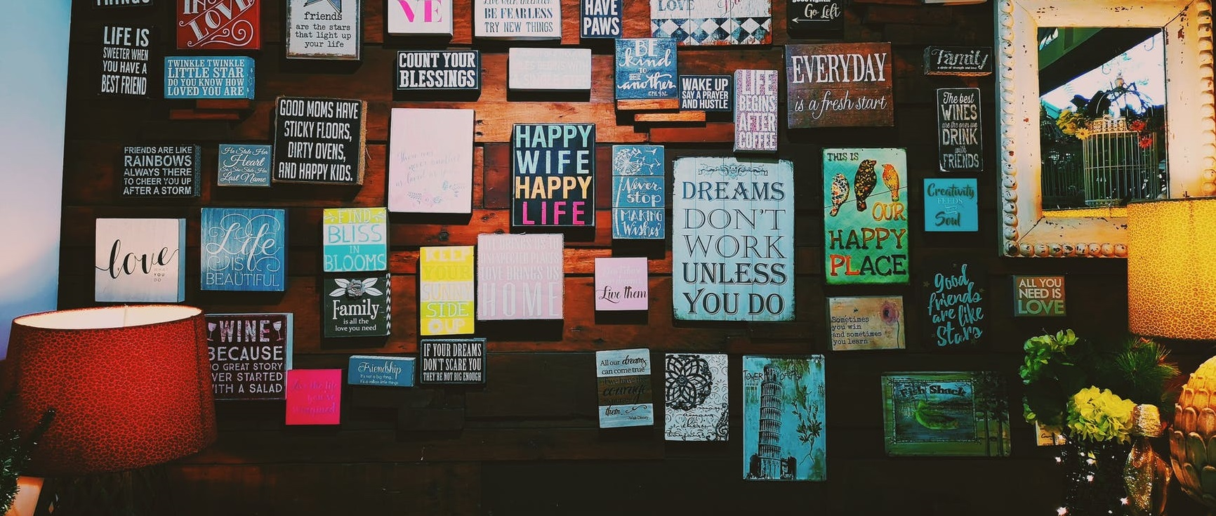 Self-affirmations displayed on a wall.